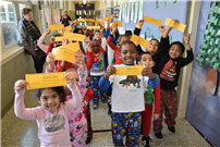 Kindergartners Hold Polar Express Tickets